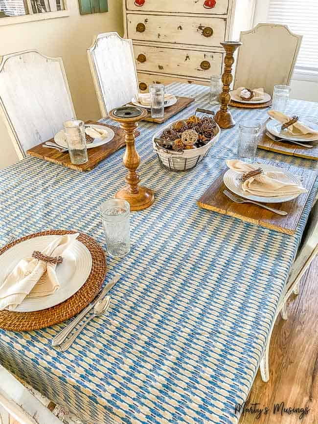 blue vintage sheet used as table cloth with wood accessories