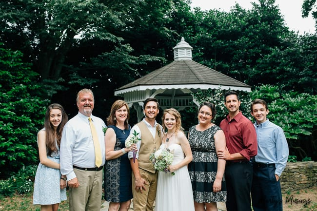 family picture outside with bride and groom