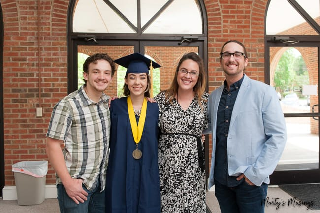 four siblings at high school graduation for girl