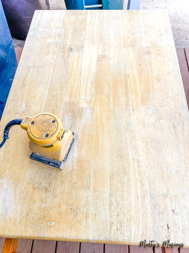 Hand sander on top of old wood surface