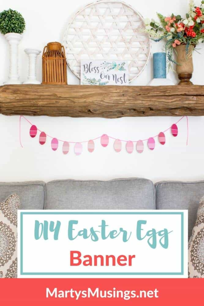 DIY Easter egg banner hung from rustic spring mantel