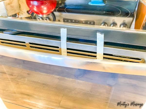tape sealing oven door for Easter Resurrection Cookies